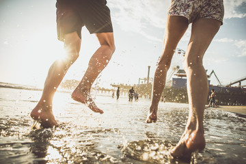 Happy couple running on the shore