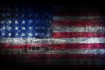 Grunge US flag on stone texture background closeup