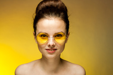 brunette woman in yellow glasess