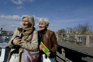 Two mature women looking over the Baltic Sea