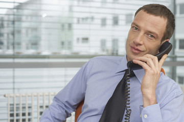 Mature man phoning