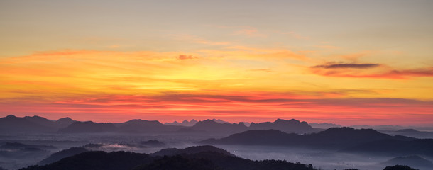 Beautiful Landscape of Sunrise with mist, sky and cloud shooting from top mountain at Phu Bo Bit, Loei, Thailand