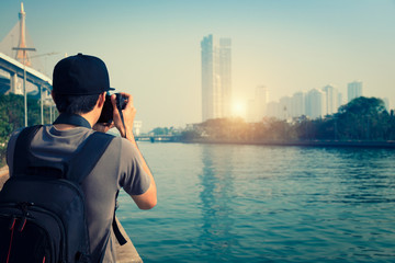 Photographer is taking a picture of sunset in bangkok Thailand.