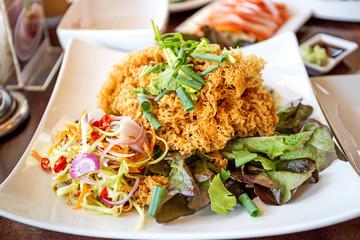 Crispy Catfish Salad Served