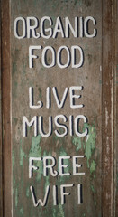 Sign Word Organic Food, Live Music, Free Wifi