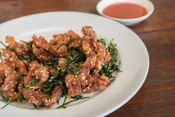 Deep fried dried pork with crispy leech lime
