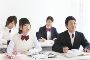 Four High School Students in Classroom