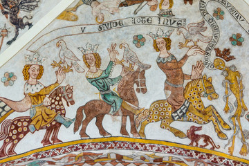 Three brave kings on horses meet the death, an old fresco painting