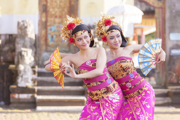 BALI - 6 March 2017 : girl performing traditional Indonesian dance at Ulun Danu temple Beratan Lake in Bali Indonesia on 6 March 2017  in Bali, Indonesia.