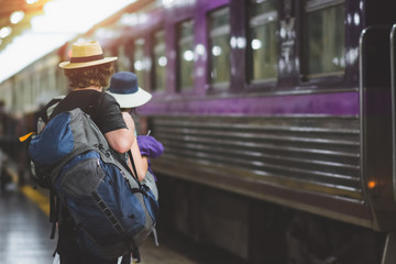 Travelers are waiting for their train. Outdoor adventure travel by train concept. Location: Bangkok, Thailand. Happy/positive/healthy hike/travel/wanderlust concept