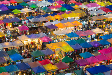 Top view over city night market, multiple colour cityscape background