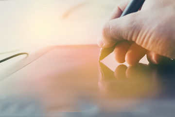 Concept of a digital signature on a tablet in the modern world.