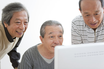 Senior Three Men at Computer