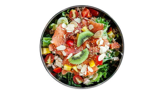 Top view bowl of smoked salmon fruit salad isolated on white background.