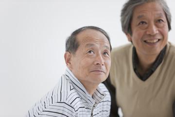 Two Senior Men Looking Up