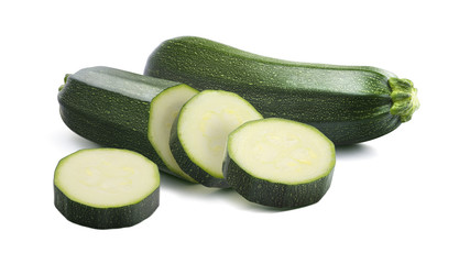 Zucchini cut pieces isolated on white background