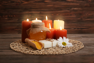 Beautiful honey spa composition on wooden background