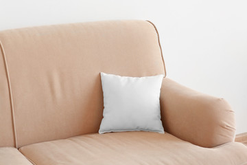 Blank soft pillow on sofa