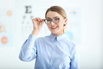 Woman with eyeglasses on blurred background