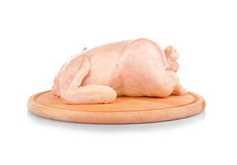 Cutting board with whole raw chicken on white background