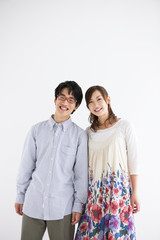 Young couple standing side by side and smiling