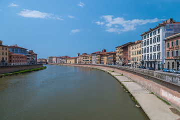 Colorful Italian buildings on the bank of the river Arno in Pisa