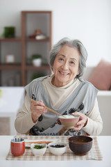 Senior woman eating lunch at home