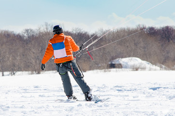 kiting on a snowboard on snow