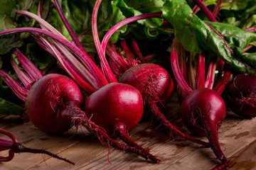 Organic Beetroot. Dark Red Beetroot on wooden background.
