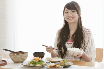 Young Woman Eating Breakfast