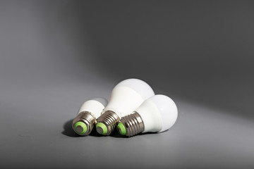 Electric light bulb on a gray background