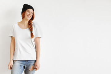 1093d404e339 Beautiful young Caucasian female with ginger hair in braid standing isolated