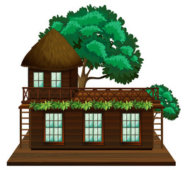 Wooden cabin with green tree
