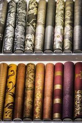 Rolls of different kinds of wallpaper