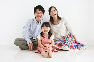 Family sitting and smiling