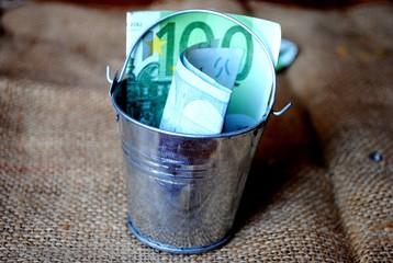 a full bucket of money