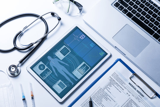 vital signs in tablet screen, medical technology concept, various medical equipments