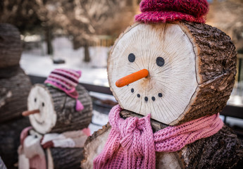 Wooden snowman with pink hat