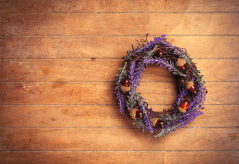 photo of cute lavender wreath with nuts on the wonderful brown wooden background