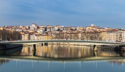 Bridge reflection on river