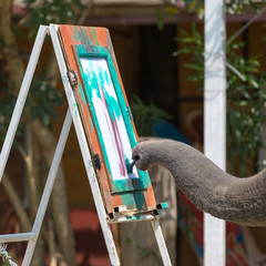 An elephant draws a picture with a brush