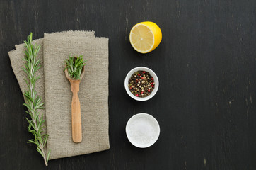 Rosemary with wooden spoon and spices