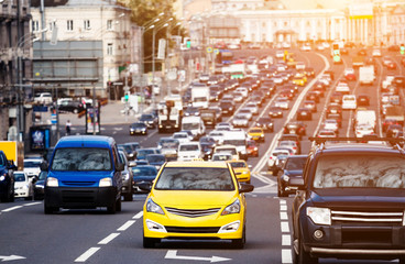 Yellow taxi on the traffic jam