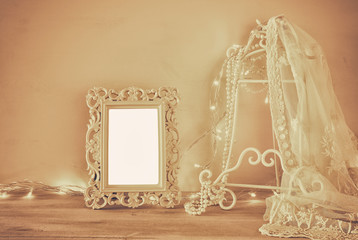 Antique blank victorian style frame on wooden table