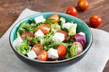 Salad with cherry tomatoes, Radicchio lettuce, frize, arugula and feta