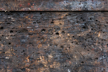 The detailed fragment of textured wooden table in the workshop with impressive structure, background, vintate, closeup