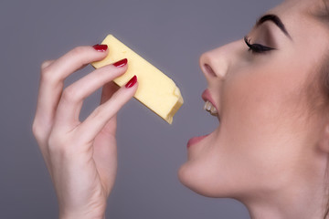 Woman eating a piece of Cheese