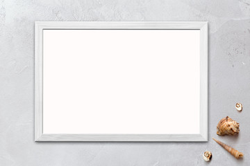 Template of blank poster in wooden frame on rustic wooden background with seashells