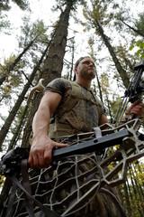 Bow hunter tracking prey