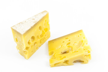 Gruyere cheese on top of a white background.